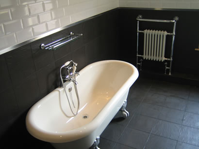 Roll-top bath and traditional heated towel rail